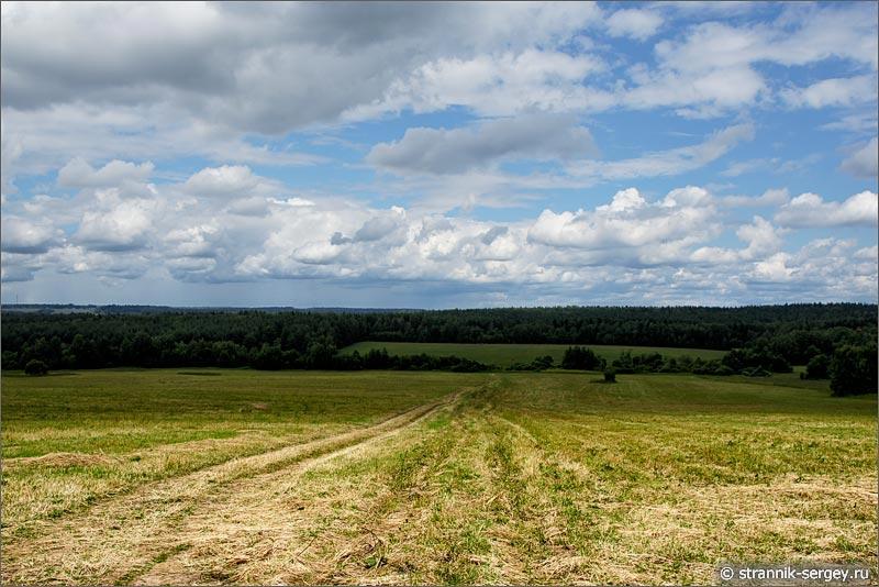 холмы долина реки поле облака